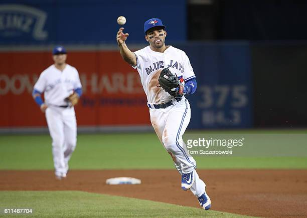 Devon Travis of the Toronto Blue Jays throws out the baserunner in the fifth inning during MLB game action against the Baltimore Orioles on September...