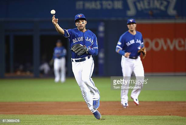 Devon Travis of the Toronto Blue Jays throws the ball for an out in the third inning against the Baltimore Orioles during the American League Wild...