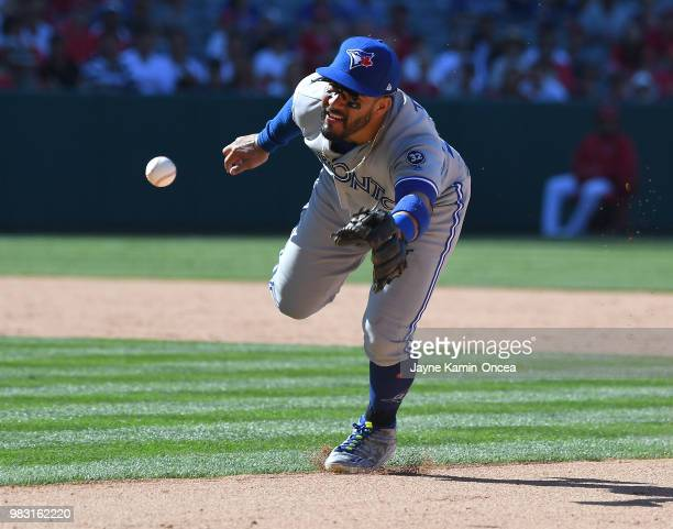 Devon Travis of the Toronto Blue Jays tosses the ball to first but unable to get Justin Upton of the Los Angeles Angels of Anaheim out in the tenth...