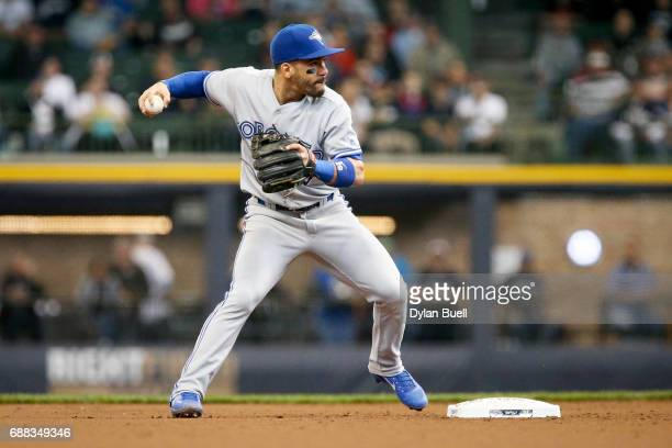 Devon Travis of the Toronto Blue Jays turns a double play in the second inning against the Milwaukee Brewers at Miller Park on May 24 2017 in...