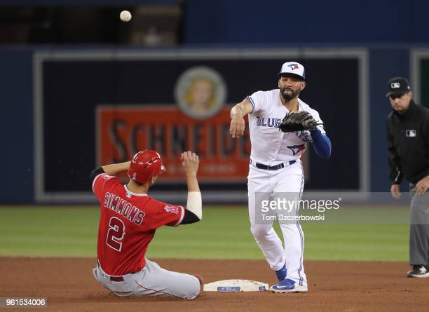Devon Travis of the Toronto Blue Jays turns a double play in the seventh inning during MLB game action as Andrelton Simmons of the Los Angeles Angels...