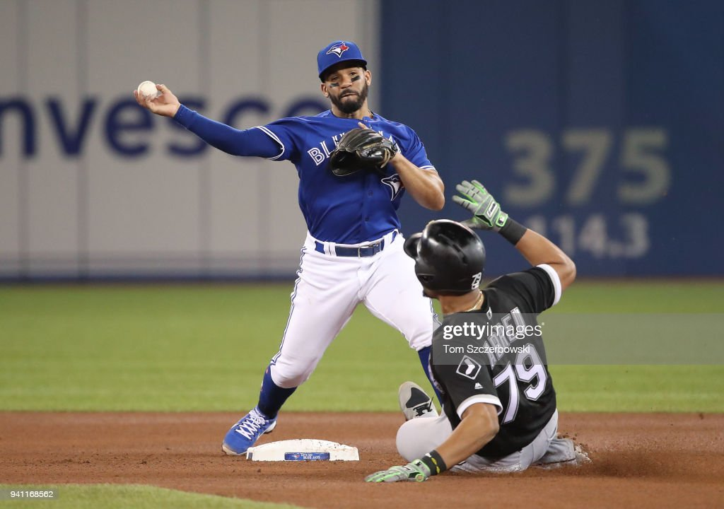 Devon Travis #29 of the Toronto Blue Jays turns a double play over Jose Abreu #79 of the Chicago White Sox at second base in the fourth inning during MLB game action at Rogers Centre on April 2, 2018 in Toronto, Canada.