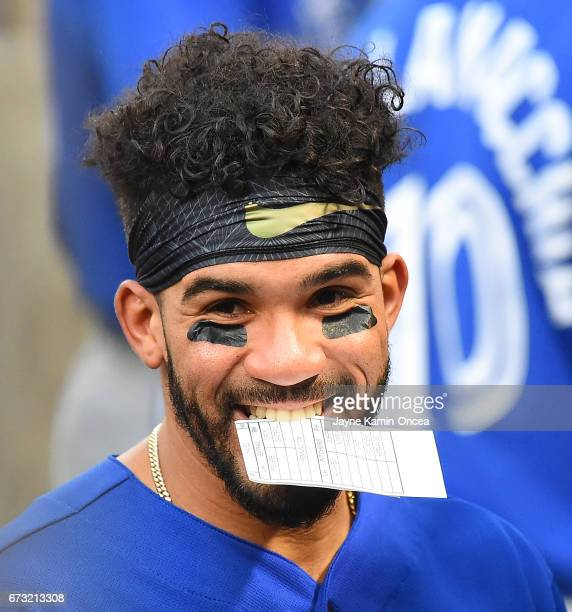 Devon Travis of the Toronto Blue Jays with the line up card before the game against the Los Angeles Angels of Anaheim at Angel Stadium of Anaheim on...