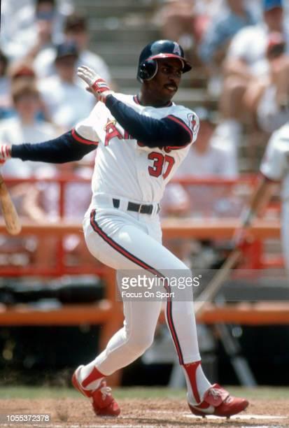 Devon White of the California Angles bats during an Major League Baseball game circa 1989 at Anaheim Stadium in Anaheim California White played for...
