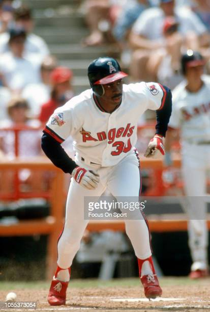 Devon White of the California Angles runs up the first base line during an Major League Baseball game circa 1989 at Anaheim Stadium in Anaheim...