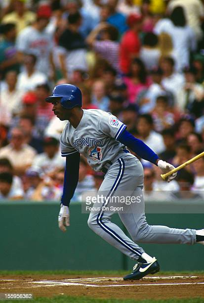 Devon White of the Toronto Blue Jays bats against the Boston Red Sox during an Major League Baseball game circa 1991 at Fenway Park in Boston...