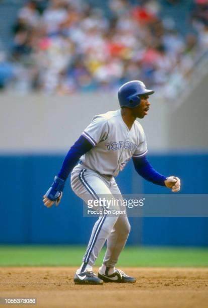Devon White of the Toronto Blue Jays leads off of second base against the New York Yankees during an Major League Baseball game circa 1991 at Yankee...