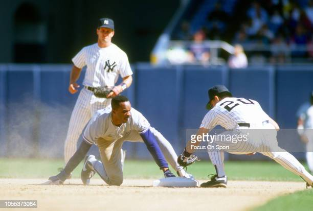 Devon White of the Toronto Blue Jays steals second base sliding in ahead of the tag of Alvaro Espinoza of the New York Yankees during an Major League...