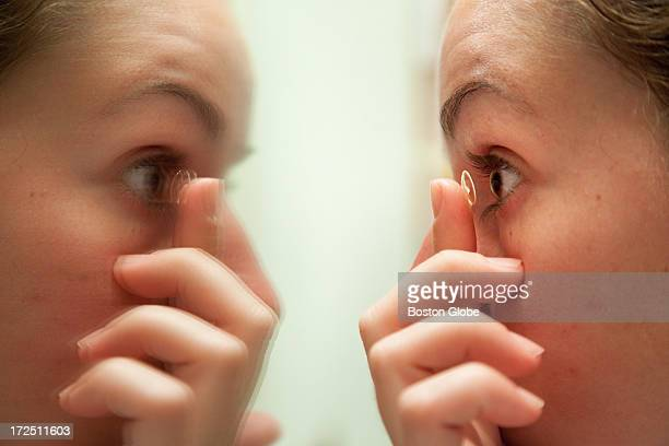 Devon Wiley of Hingham demonstrates how she puts in her Ortho K contacts for the evening The story is about Orthokerantology which is an alternative...