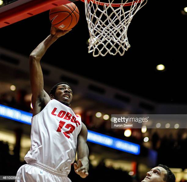 Devon Williams of the New Mexico Lobos goes up for two points against JJ Avila of the Colorado State Rams during their game at The WisePies Arena on...
