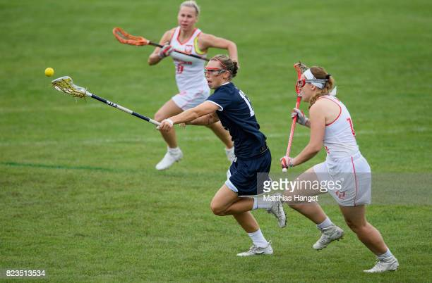 Devon Wills of the United States is tracked by Joanna Wawrzynow of Poland during the Lacrosse Women's match between USA and Poland of The World Games...