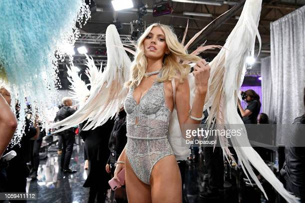 Devon Windsor poses backstage during the 2018 Victoria's Secret Fashion Show at Pier 94 on November 8 2018 in New York City