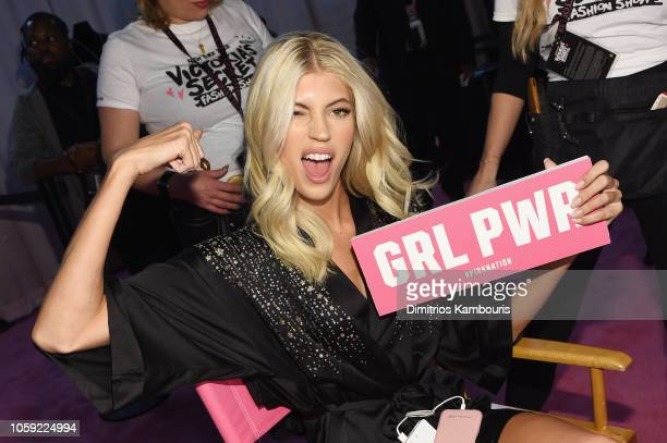 Devon Windsor prepares backstage during the 2018 Victoria's Secret Fashion Show in New York at Pier 94 on November 8 2018 in New York City