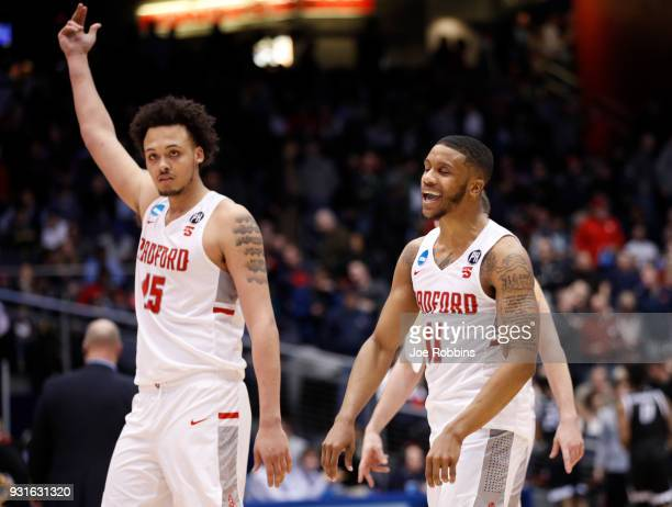 Devonnte Holland and Travis Fields Jr of the Radford Highlanders celebrate their teams victory over the Long Island Blackbirds in the First Four game...