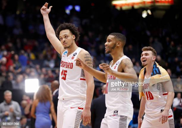 Devonnte Holland Travis Fields Jr and Caleb Tanner of the Radford Highlanders celebrate their teams victory over the Long Island Blackbirds in the...