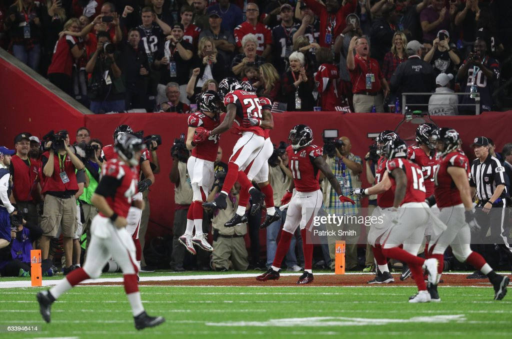 Devonta Freeman #24 of the Atlanta Falcons celebrates a 5-yard touchdown in the second quarter with teammates against the New England Patriots during Super Bowl 51 at NRG Stadium on February 5, 2017 in Houston, Texas.
