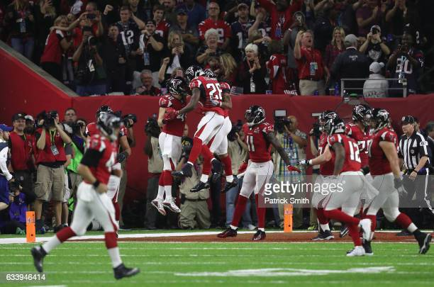 Devonta Freeman of the Atlanta Falcons celebrates a 5yard touchdown in the second quarter with teammates against the New England Patriots during...