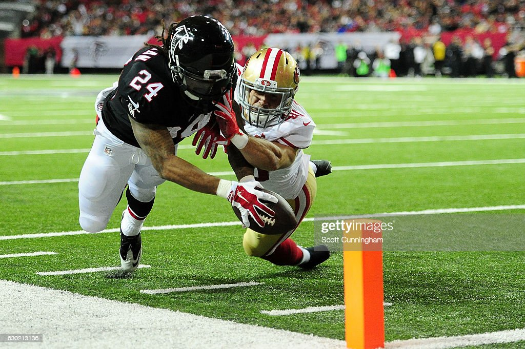 Devonta Freeman #24 of the Atlanta Falcons fails to reach the pylon against Vinnie Sunseri #40 of the San Francisco 49ers during the first half at the Georgia Dome on December 18, 2016 in Atlanta, Georgia.