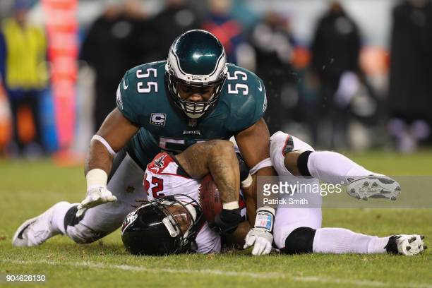Devonta Freeman of the Atlanta Falcons gets tackled by Brandon Graham of the Philadelphia Eagles during the fourth quarter in the NFC Divisional...