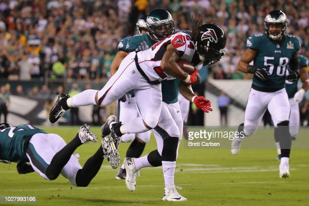 Devonta Freeman of the Atlanta Falcons is tackled by Malcolm Jenkins of the Philadelphia Eagles during the first half at Lincoln Financial Field on...