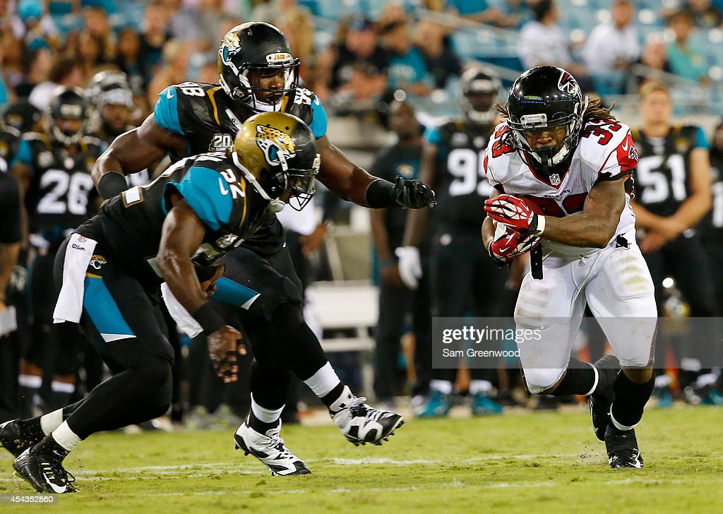 Devonta Freeman #33 of the Atlanta Falcons runs for yardage during the preseason NFL game against the Jacksonville Jaguars at EverBank Field on August 28, 2014 in Jacksonville, Florida.