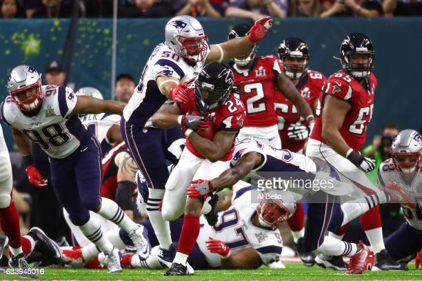 Devonta Freeman of the Atlanta Falcons runs the ball against Rob Ninkovich of the New England Patriots in the first quarter during Super Bowl 51 at...