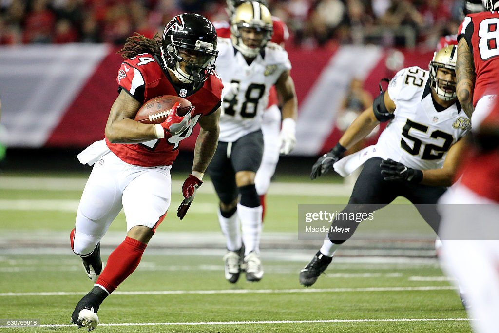 Devonta Freeman #24 of the Atlanta Falcons runs the ball during the first half against the New Orleans Saints at the Georgia Dome on January 1, 2017 in Atlanta, Georgia.