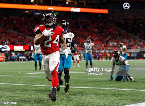 Devonta Freeman of the Atlanta Falcons rushes for a touchdown against the Jacksonville Jaguars in the first quarter at Mercedes-Benz Stadium on...