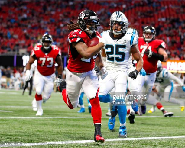 Devonta Freeman of the Atlanta Falcons rushes in for a touchdown in the second half on an NFL game against the Carolina Panthers at Mercedes-Benz...