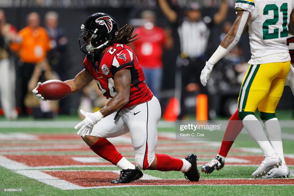 Devonta Freeman #24 of the Atlanta Falcons scores a 2-yard rushing touchdown during the second quarter against the Green Bay Packers at Mercedes-Benz Stadium on September 17, 2017 in Atlanta, Georgia.