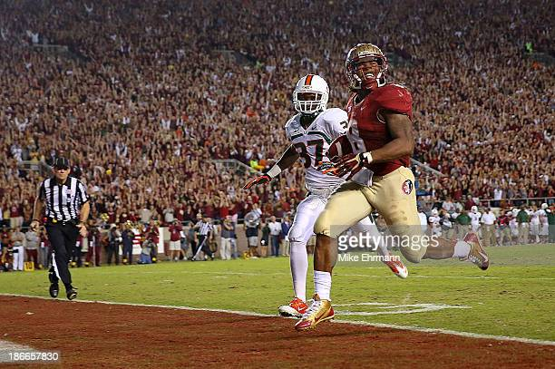 Devonta Freeman of the Florida State Seminoles scores a touchdown during a game against the Miami Hurricanes at Doak Campbell Stadium on November 2...