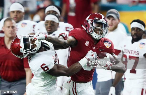 DeVonta Smith of the Alabama Crimson Tide breaks away from the defense of Tre Brown of the Oklahoma Sooners in the second quarter during the College...