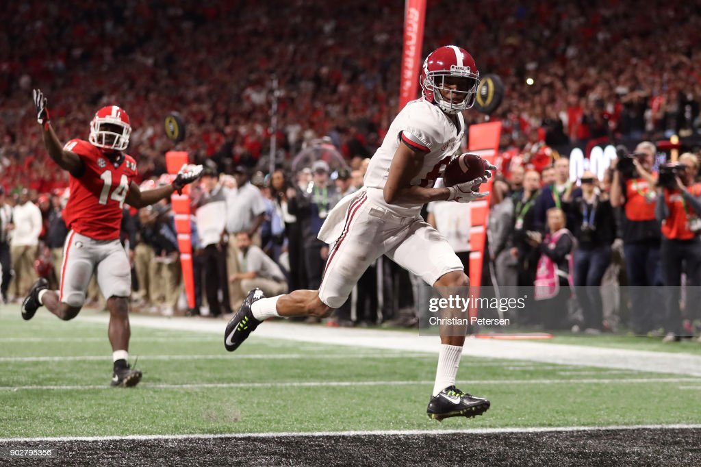 DeVonta Smith #6 of the Alabama Crimson Tide catches a 41 yard touchdown pass to beat the Georgia Bulldogs in the CFP National Championship presented by AT&T in overtime at Mercedes-Benz Stadium on January 8, 2018 in Atlanta, Georgia.