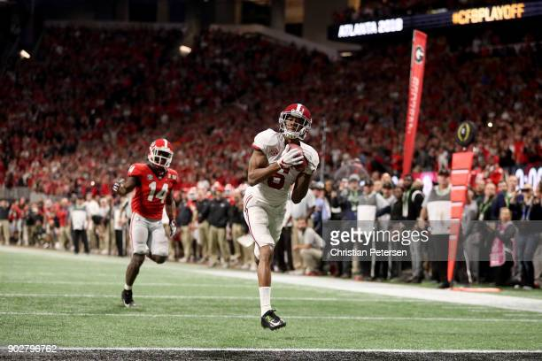 DeVonta Smith of the Alabama Crimson Tide catches a 41 yard touchdown pass to beat the Georgia Bulldogs in the CFP National Championship presented by...