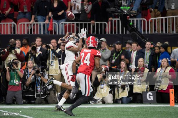 DeVonta Smith of the Alabama Crimson Tide catches the winning touchdown against the Georgia Bulldogs during the College Football Playoff National...