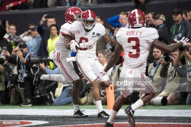 DeVonta Smith of the Alabama Crimson Tide celebrates after catching the winning touchdown against the Georgia Bulldogs during the College Football...