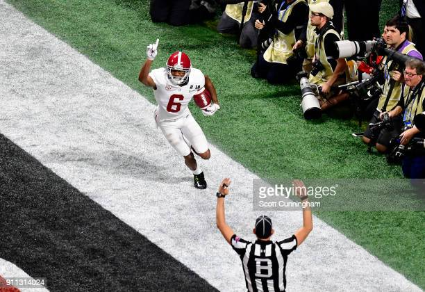 DeVonta Smith of the Alabama Crimson Tide celebrates after making the gamewinning touchdown catch in overtime to defeat the Georgia Bulldogs in the...