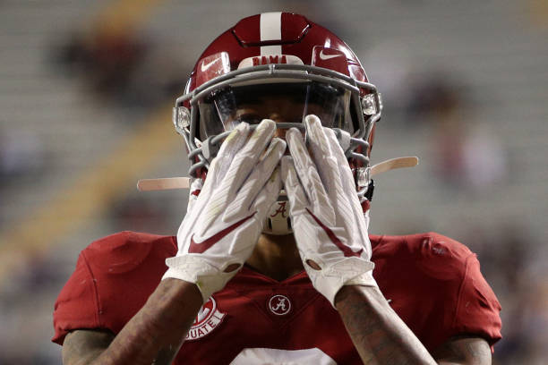 DeVonta Smith of the Alabama Crimson Tide celebrates after scoring a touchdown against the LSU Tigers at Tiger Stadium on December 05, 2020 in Baton...