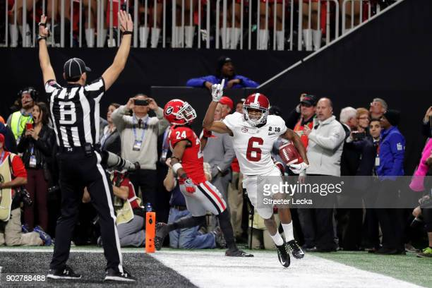 DeVonta Smith of the Alabama Crimson Tide celebrates catching a 41 yard touchdown pass to beat the Georgia Bulldogs in the CFP National Championship...