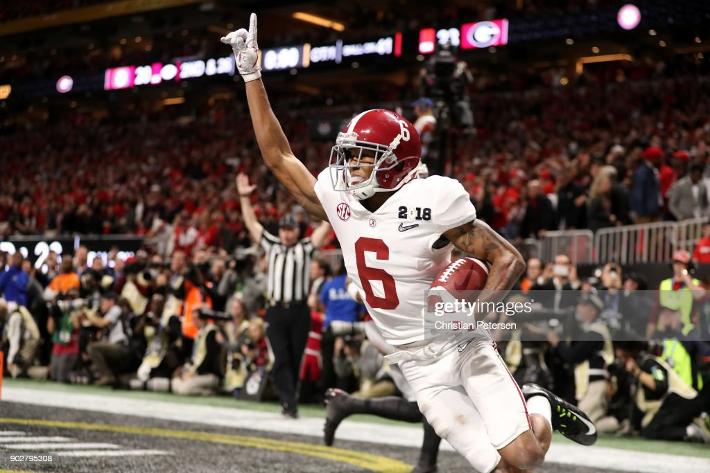 DeVonta Smith #6 of the Alabama Crimson Tide celebrates catching a 41 yard touchdown pass to beat the Georgia Bulldogs in the CFP National Championship presented by AT&T in overtime at Mercedes-Benz Stadium on January 8, 2018 in Atlanta, Georgia. Alabama won 26-23.