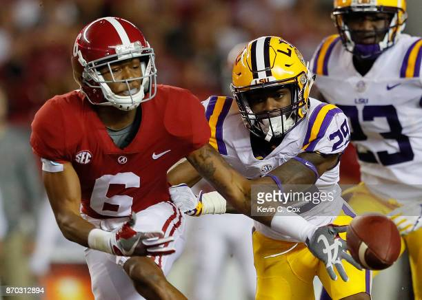 DeVonta Smith of the Alabama Crimson Tide fails to pull in this reception against Andraez Williams of the LSU Tigers at BryantDenny Stadium on...