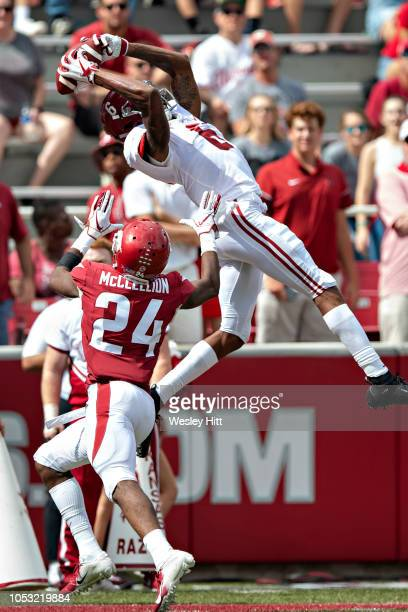 DeVonta Smith of the Alabama Crimson Tide makes a catch but is out of bounds over Jarques McClellion of the Arkansas Razorbacks at Razorback Stadium...