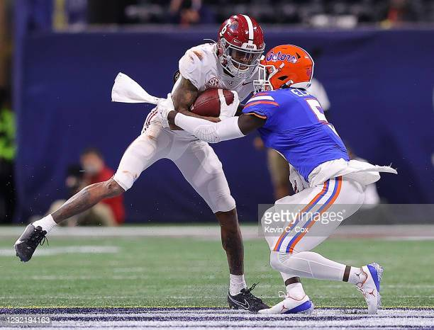 DeVonta Smith of the Alabama Crimson Tide pulls in this reception as he is tackled by Kaiir Elam of the Florida Gators during the second half of the...