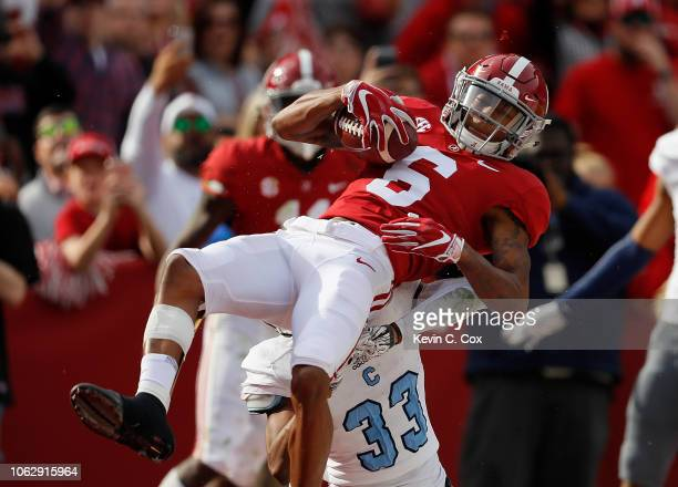 DeVonta Smith of the Alabama Crimson Tide pulls in this touchdown reception against Ronald Peterkin of the Citadel Bulldogs at BryantDenny Stadium on...