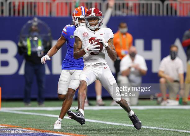 DeVonta Smith of the Alabama Crimson Tide pulls in this touchdown reception against Marco Wilson of the Florida Gators during the second half of the...
