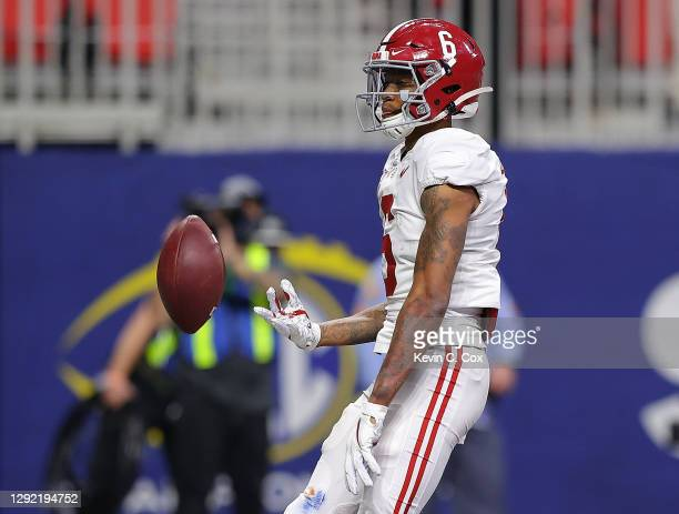 DeVonta Smith of the Alabama Crimson Tide reacts after this touchdown reception against the Florida Gators during the second half of the SEC...