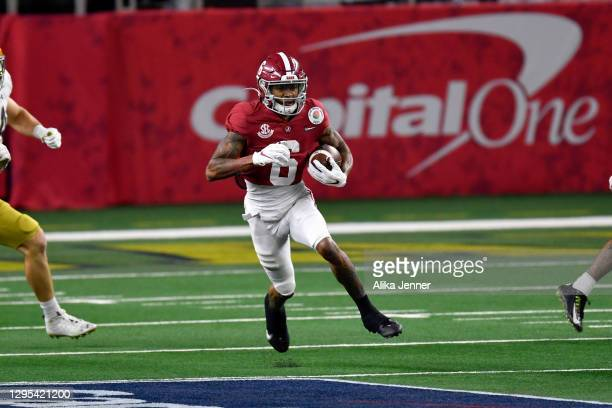 DeVonta Smith of the Alabama Crimson Tide runs the ball during the College Football Playoff Semifinal at the Rose Bowl football game Notre Dame...