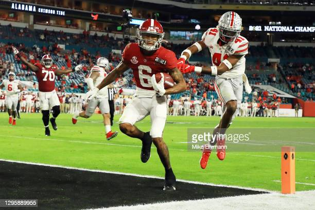 DeVonta Smith of the Alabama Crimson Tide rushes for a five yard touchdown during the second quarter of the College Football Playoff National...