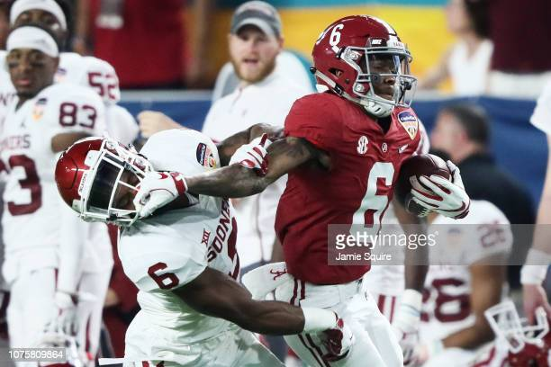 DeVonta Smith of the Alabama Crimson Tide rushes in the first quarter against the Oklahoma Sooner during the College Football Playoff Semifinal at...