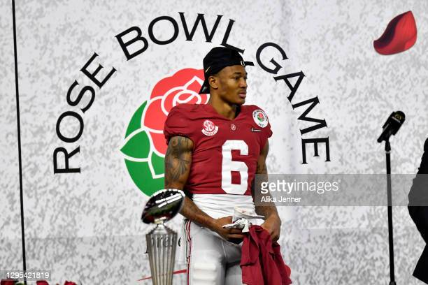 DeVonta Smith of the Alabama Crimson Tide stands on the trophy presentation stage after the College Football Playoff Semifinal at the Rose Bowl...